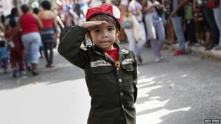 A child dressed as former Venezuelan President Hugo Chavez at a parade during the Carnival festival in Caracas on 4 March, 2014