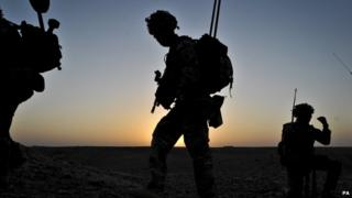 Three soldiers seen in silhouette in Afghanistan