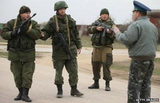 Col Yuli Mamchuck, right, speaks to troops under Russian command occupying the Belbek airbase in Crimea
