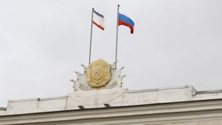 Crimea and Russia flags above parliament building