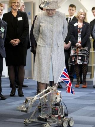 The Queen sees a robot demonstration at Reed's School, Cobham