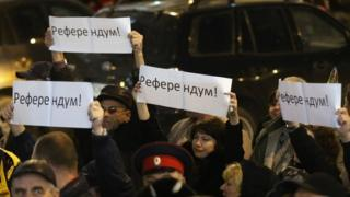 Pro-Russian protesters holding signs that read 'Referendum!. in Crimea in Ukraine - 6 March 2014