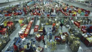 Staff on a night shift at Royal Mail's sorting office in Filton near Bristol