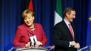 German Chancellor Angela Merkel and Irish Prime Minister Enda Kenny smile during a news conference in Government Buildings in Dublin