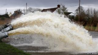 Flood water is pumped into the River Parrott by the Environment Agency in Moorland