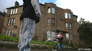 Children playing by boarded-up houses