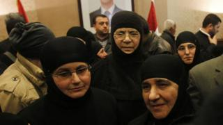 Nuns arrive at the Syrian border with Lebanon at the Jdaydeh Yaboos crossing, early March 10, 2014.
