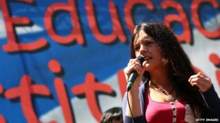 The leader of the student movement of Chile, Camila Vallejo, speaks to the crowd on the second day of a 48-hour demonstration to press the government of President Sebastian Pinera to reform the country's education system in Santiago on 19 October, 2011
