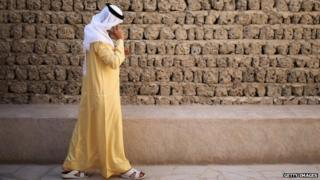 An Emirati man talks on the phone