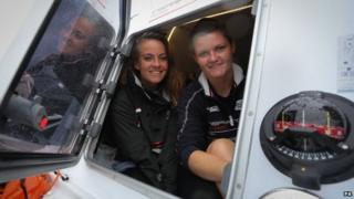 Lauren Morton (left) and Hannah Lawton in the cabin of their boat