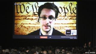 Edward Snowden appeared on video before a hall of convention-goers at the South by Southwest Interactive convention on Monday