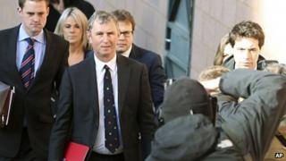 Nigel Evans, centre, is photographed walking into court