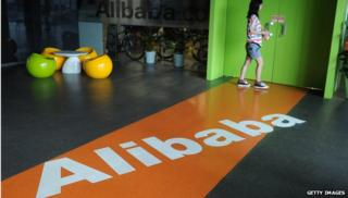 Alibaba logo on floor with woman