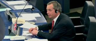 Nigel Farage listens to the comments from Nikki Sinclaire