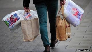 A man carrying Tesco shopping bags