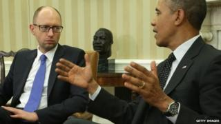 US President Barack Obama (R) meets with Prime Minister of Ukraine Arseniy Yatsenyuk (L) in the Oval Office of the White House 12 March 2014