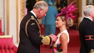 Katherine Jenkins collects her OBE from Prince Charles