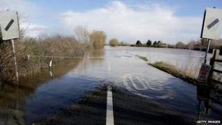 Flood water covers the main A361 road as it enters the village of East Lyng on February 13