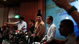 Malaysian government officials hold a press conference on the disappearance of flight MH370 on 14 March, 2014.