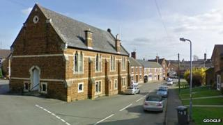 View of Finedon High Street and library