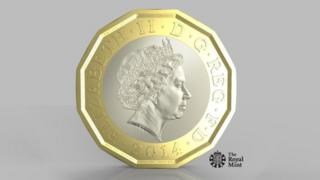 The new pound coin design. A twelve sided coin in gold, with a silver disc inset. The Queen features prominently.