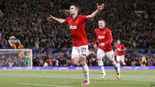 Robin van Persie celebrates after scoring a goal