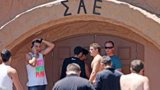 Students stand outside the Sigma Alpha Epsilon fraternity house on 20 April, 2012.