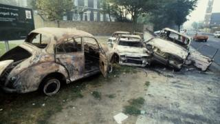 Burned-out cars after the Brixton riots