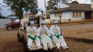 Library picture of health workers dressed in special head-to-toe Ebola suits (2005)