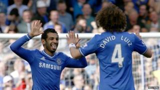 Salaz and Luiz celebrate a goal