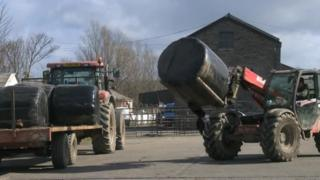 Silage being loaded