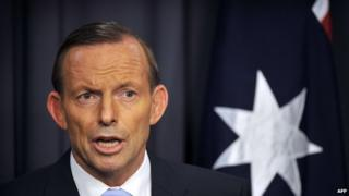 Australia's Prime Minister Tony Abbott speaks to the media at Parliament House in the capital Canberra on March 25, 2014