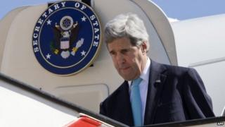 John Kerry arrives in Jordan's capital, Amman (26 March 2014)