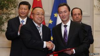 Airbus boss Fabrice Bregier, shakes hands with China's Li Hai at the Elysee Palace in Paris