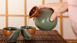 Woman pouring sake