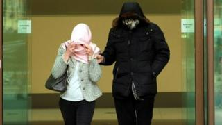 Domenico Rancadore and his wife had their faces covered as they left Westminster Magistrates' Court