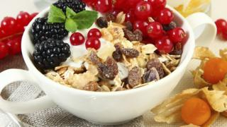 muesli and fruit in cereal bowl