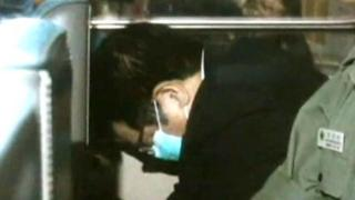 Carson Yeung hiding in a car