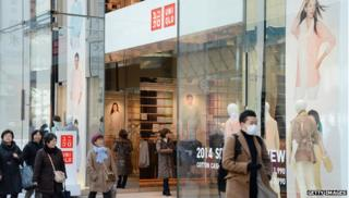 Shoppers outside Uniqlo