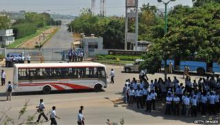 Toyota workers outside plant with bus