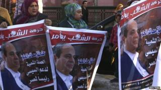 "Supporters of Egypt""s former army chief Field Marshal Abdel Fattah al-Sisi celebrate the announcement of his candidacy"