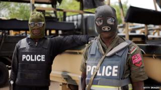 Nigerian police officers pose prior to a patrol in former Boko Haram headquarters in Maiduguri on in June 2013.