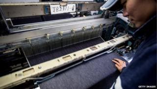 Japanese worker at denim factory
