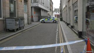 Police tape and car near Queensgate in Inverness