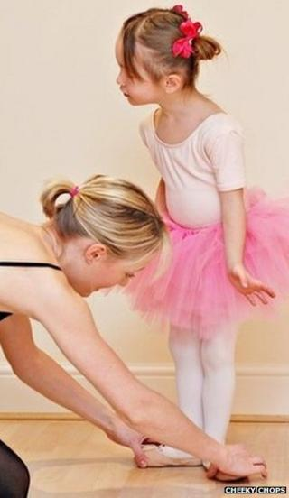 Girl ballerina in pink tutu