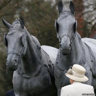 The Queen, Prince Philip and Prince William with the life-sized horse sculpture in Windsor
