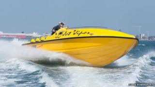 Saber Powersports boat at high speed
