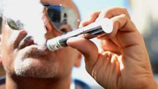 Man smoking electronic cigarette