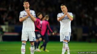 Gary Cahill and John Terry applaud fans after their match