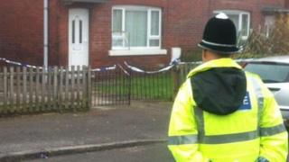 Police officer outside the house in Cudworth